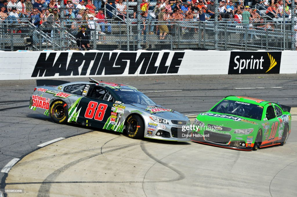 Dale Earnhardt Jr., driver of the #88 Diet Mountain Dew Chevrolet, and Danica Patrick, driver of the #10 GoDaddy.com Chevrolet, are involved in an incident during the NASCAR Sprint Cup Series STP Gas Booster 500 on April 7, 2013 at Martinsville Speedway in Ridgeway, Virginia.