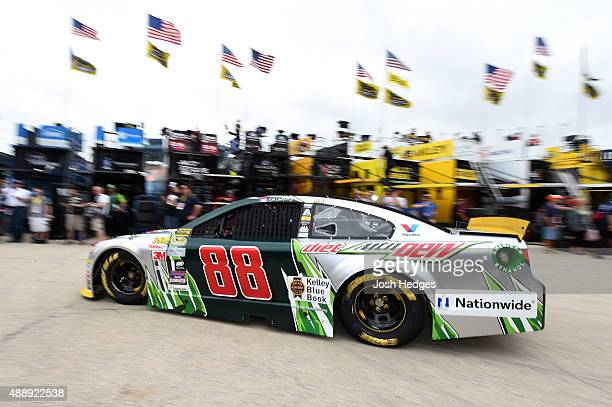 Dale Earnhardt Jr driver of the DIET MOUNTAIN DEW Chevrolet drives in the garage area during practice for the NASCAR Sprint Cup Series myAFibRiskcom...
