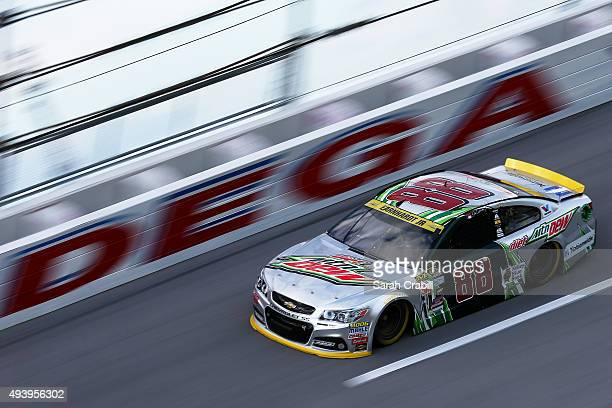 Dale Earnhardt Jr driver of the Diet Mountain Dew Chevrolet practices for the NASCAR Sprint Cup Series CampingWorldcom 500 at Talladega Superspeedway...
