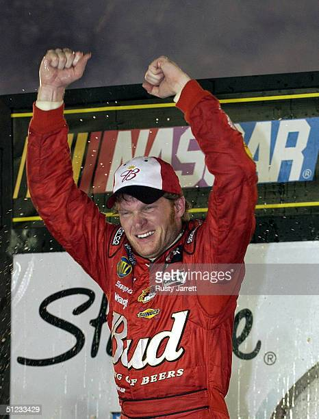 Dale Earnhardt Jr driver of the Earnhardt Racing Chevrolet celebrates winning the NASCAR Nextel Cup series Sharpie 500 on August 28 2004 at Bristol...