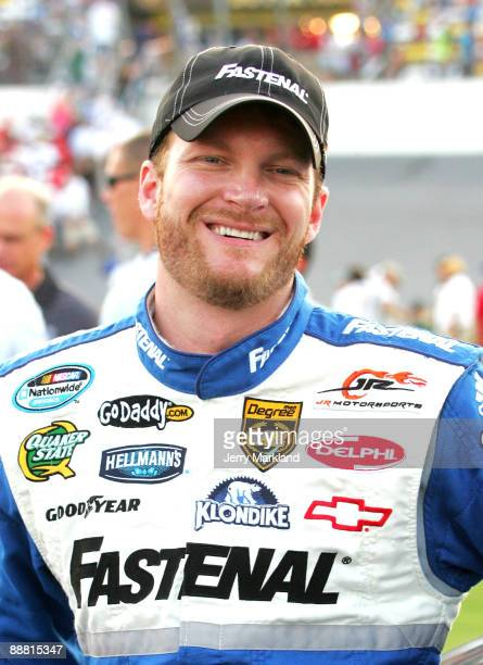 Dale Earnhardt Jr, driver of the Fastenal Chevrolet, stands on the grid prior to the start of the NASCAR Nationwide Series Subway Jalapeno 250 at...