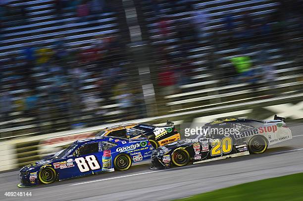 Dale Earnhardt Jr driver of the Goody's Chevrolet leads Erik Jones driver of the GameStop/Mortal Kombat X Toyota during the NASCAR XFINITY Series...