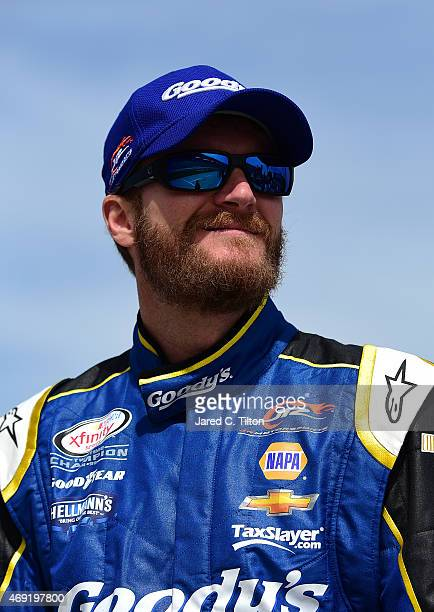Dale Earnhardt Jr driver of the Goody's Chevrolet looks on from the grid during qualifying for the NASCAR XFINITY Series O'Reilly Auto Parts 300 at...