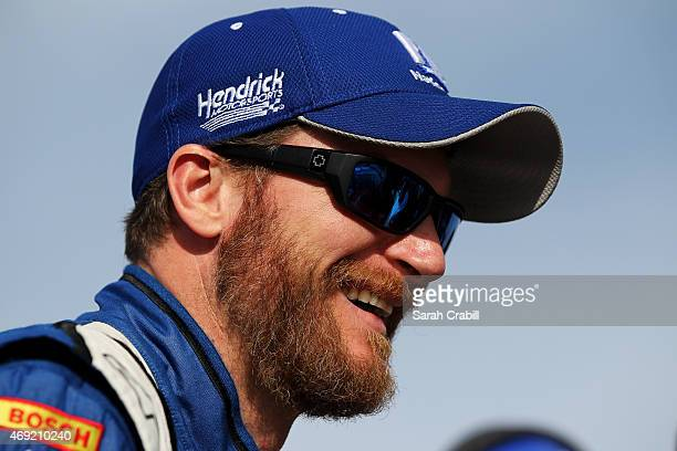 Dale Earnhardt Jr driver of the Goody's Chevrolet looks on from the grid during qualifying for the NASCAR Sprint Cup Series Duck Commander 500 at...