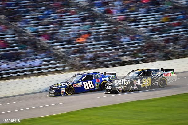 Dale Earnhardt Jr driver of the Goody's Chevrolet races Erik Jones driver of the GameStop/Mortal Kombat X Toyota during the NASCAR XFINITY Series...