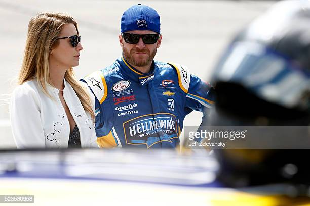 Dale Earnhardt Jr driver of the Hellmann's Chevrolet and his girlfriend Amy Reimann stand on the grid prior to the NASCAR XFINITY Series ToyotaCare...