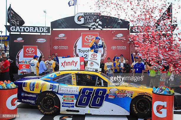Dale Earnhardt Jr driver of the Hellmann's Chevrolet celebrates in Vitory Lane after winning the NASCAR XFINITY Series ToyotaCare 250 at Richmond...