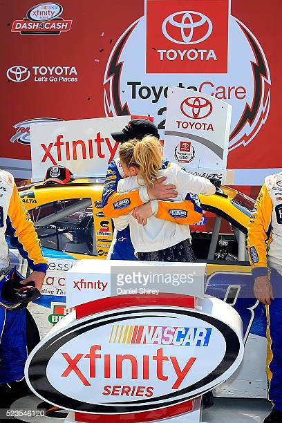 Dale Earnhardt Jr driver of the Hellmann's Chevrolet celebrates with his girlfriend Amy Reimann in Victory Lane after winning the NASCAR XFINITY...