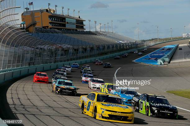 Dale Earnhardt Jr., driver of the Hellmann's Chevrolet, leads a pack of cars during the NASCAR Xfinity Series Hooters 250 at Homestead-Miami Speedway...