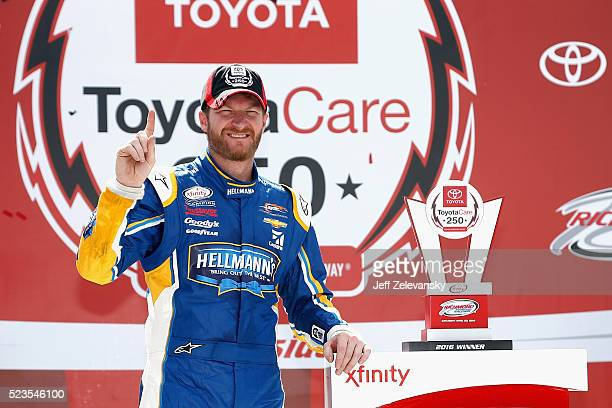 Dale Earnhardt Jr driver of the Hellmann's Chevrolet poses for a photo in Victory Lane after winning the NASCAR XFINITY Series ToyotaCare 250 at...