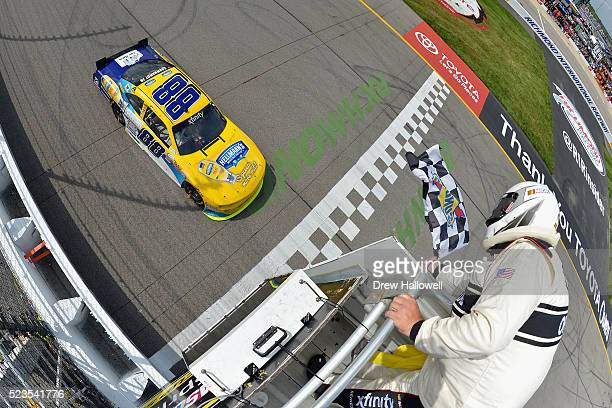 Dale Earnhardt Jr driver of the Hellmann's Chevrolet takes the checkered flag to win the NASCAR XFINITY Series ToyotaCare 250 at Richmond...