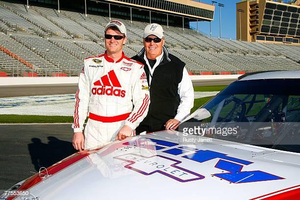 Dale Earnhardt Jr driver of the Hendricks Motorsports Chevrolet and team owner Rick Hendrick pose with the Hendricks Motorsports car during NASCAR...