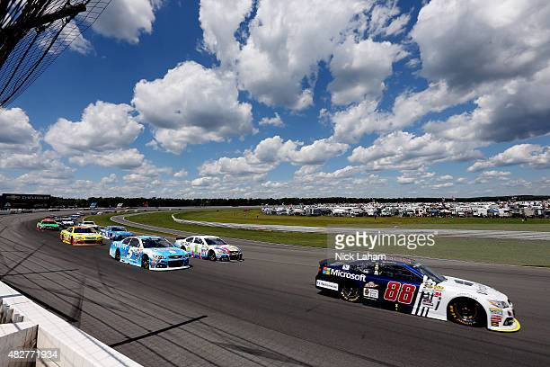 Dale Earnhardt Jr., driver of the Microsoft Chevrolet, leads a pack of cars during the NASCAR Sprint Cup Series Windows 10 400 at Pocono Raceway on...