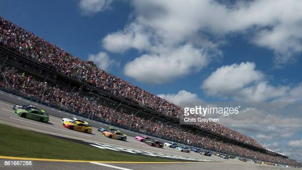 Dale Earnhardt Jr driver of the Mountain Dew Chevrolet and Chase Elliott driver of the NAPA Chevrolet lead the field at the star of the Monster...
