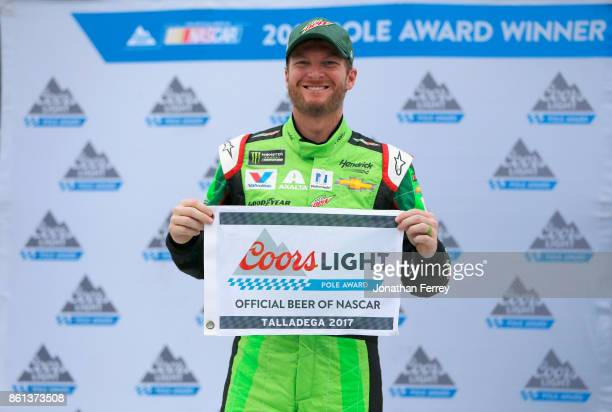 Dale Earnhardt Jr driver of the Mountain Dew Chevrolet poses with the Coors Light Pole Award after qualifying in the pole position for the Monster...