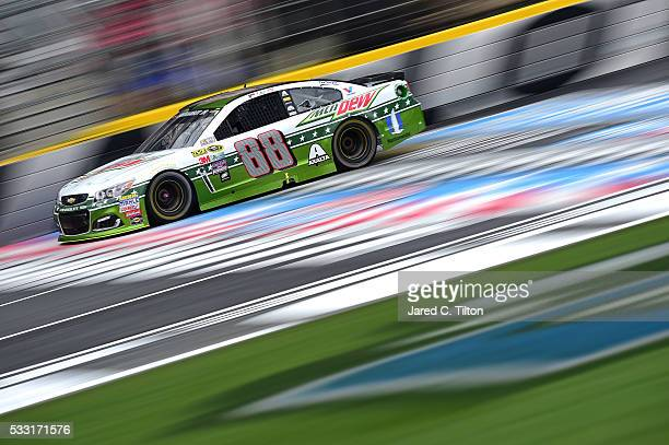 Dale Earnhardt Jr driver of the Mountain Dew Chevrolet practices for the NASCAR Sprint Cup Series Sprint AllStar Race at Charlotte Motor Speedway on...