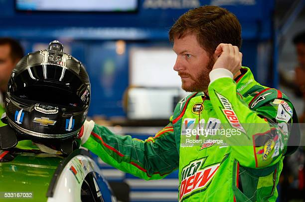 Dale Earnhardt Jr driver of the Mountain Dew Chevrolet prepares for practice for the NASCAR Sprint Cup Series Sprint AllStar Race at Charlotte Motor...