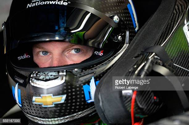 Dale Earnhardt Jr driver of the Mountain Dew Chevrolet sits in his car prior to practice for the NASCAR Sprint Cup Series Sprint AllStar Race at...