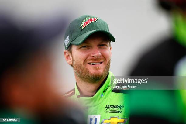 Dale Earnhardt Jr driver of the Mountain Dew Chevrolet stands on the grid during qualifying for the Monster Energy NASCAR Cup Series Alabama 500 at...