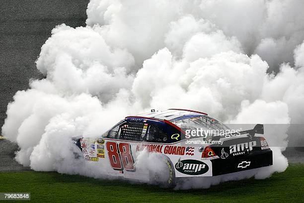 Dale Earnhardt Jr driver of the Mountian Dew AMP/National Guard Chevrolet burns out after winning the Budweiser Shootout at Daytona International...