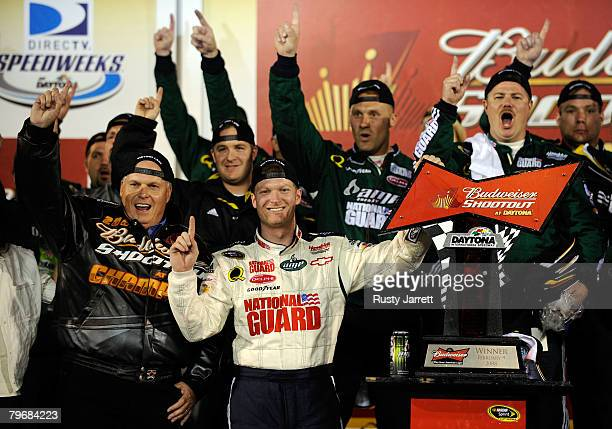 Dale Earnhardt Jr driver of the Mountian Dew AMP/National Guard Chevrolet celebrates in victory lane with team owner Rick Hendrick after winning the...