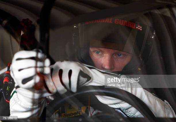 Dale Earnhardt Jr driver of the Mountian Dew AMP/National Guard Chevrolet sits in his car in the garage during practice for the Daytona 500 at...