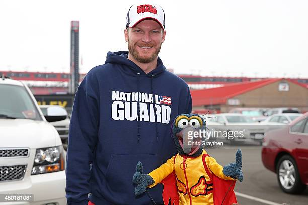 Dale Earnhardt Jr driver of the National Guard Chevrolet and The Great Gonzo are seen in the garage area prior to the NASCAR Sprint Cup Series Auto...