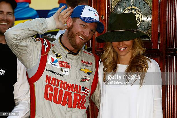 Dale Earnhardt Jr driver of the National Guard Chevrolet celebrates with girlfriend Amy Reimann in Victory Lane after his victory in the NASCAR...