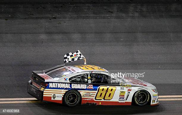 Dale Earnhardt Jr driver of the National Guard Chevrolet celebrates with the checkered flag after winning the NASCAR Sprint Cup Series Daytona 500 at...