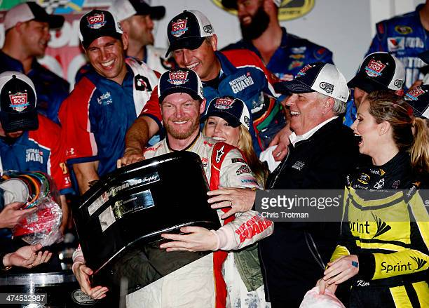 Dale Earnhardt Jr driver of the National Guard Chevrolet celebrates in Victory Lane with his girlfriend Amy Reimann and team owner Rick Hendrick...