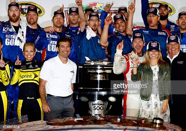 Dale Earnhardt Jr driver of the National Guard Chevrolet celebrates in Victory Lane with his girlfriend Amy Reimann team owner Rick Hendrick and Joie...