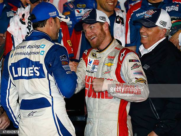 Dale Earnhardt Jr driver of the National Guard Chevrolet celebrates in Victory Lane with Jimmie Johnson driver of the Lowe's Chevrolet and team owner...