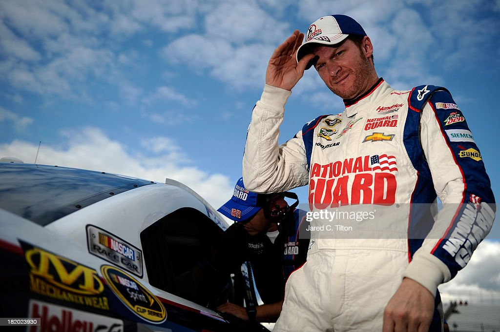Dale Earnhardt Jr., driver of the #88 National Guard Chevrolet, climbs out of his car after \qualifying for the NASCAR Sprint Cup Series AAA 400 at Dover International Speedway on September 27, 2013 in Dover, Delaware.