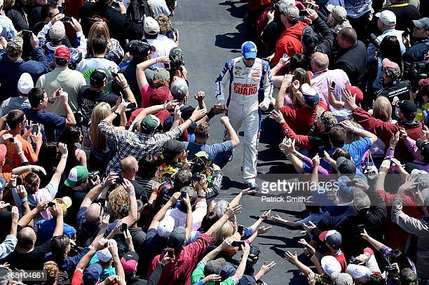 Dale Earnhardt Jr driver of the National Guard Chevrolet greets fans during driver introductions prior to the start of the NASCAR Sprint Cup Series...