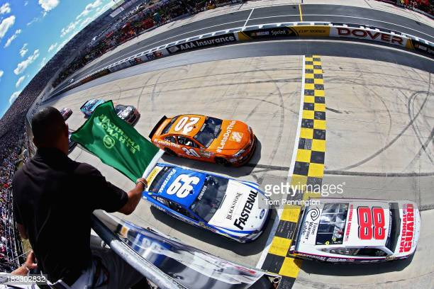 Dale Earnhardt Jr driver of the National Guard Chevrolet leads the field to the green flag for the start of the NASCAR Sprint Cup Series AAA 400 at...