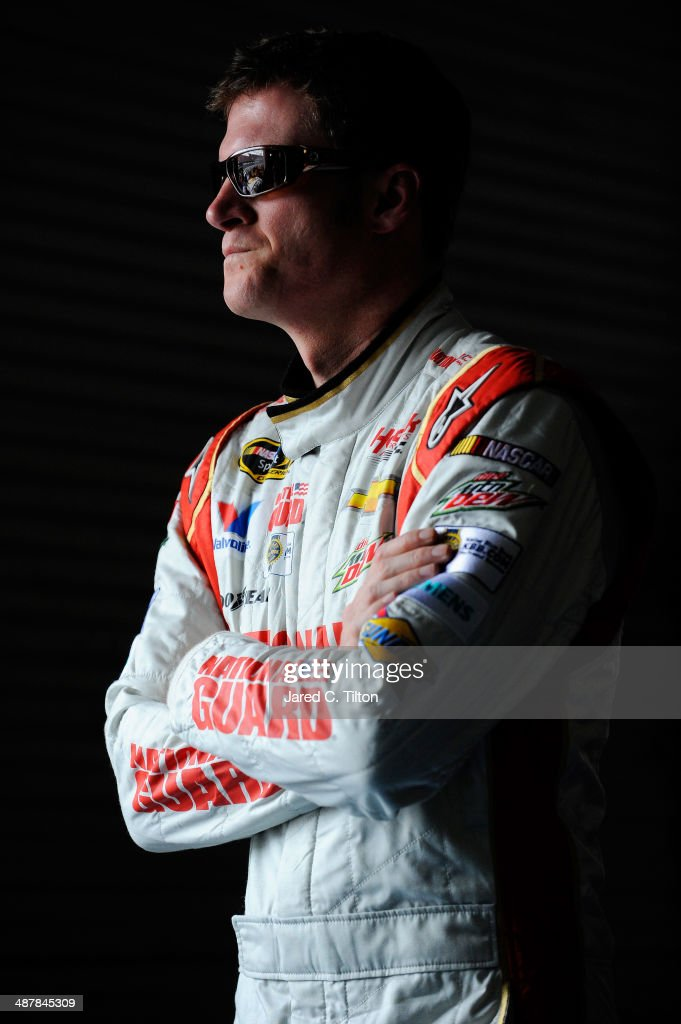 Dale Earnhardt Jr., driver of the #88 National Guard Chevrolet, looks on in the garage area during practice for the NASCAR Sprint Cup Series Aaron's 499 at Talladega Superspeedway on May 2, 2014 in Talladega, Alabama.