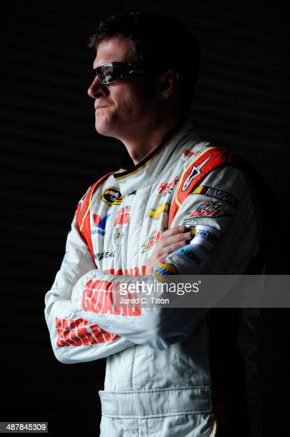 Dale Earnhardt Jr driver of the National Guard Chevrolet looks on in the garage area during practice for the NASCAR Sprint Cup Series Aaron's 499 at...