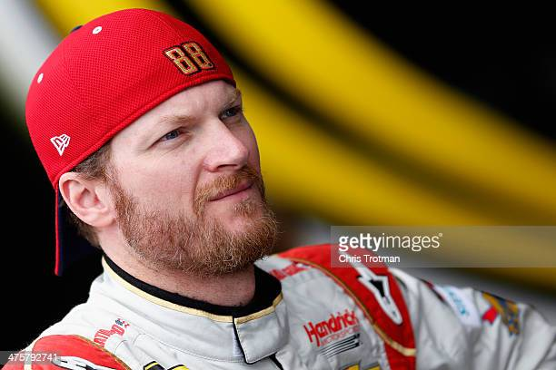 Dale Earnhardt Jr driver of the National Guard Chevrolet looks on during practice for the NASCAR Sprint Cup Series The Profit on CNBC 500 at Phoenix...