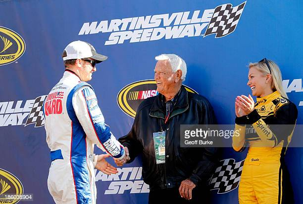 Dale Earnhardt Jr driver of the National Guard Chevrolet meets with NASCAR Hall of Famer and race Grand Marshal Junior Johnson before the start of...
