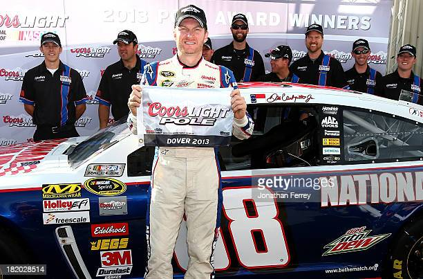 Dale Earnhardt Jr driver of the National Guard Chevrolet poses in Victory Lane after qualifying for the pole position in the NASCAR Sprint Cup Series...