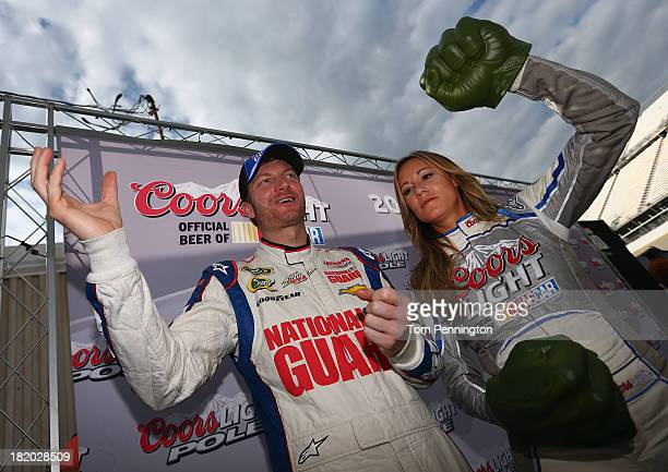 Dale Earnhardt Jr driver of the National Guard Chevrolet poses with Miss Coors Light Rachel Rupert in Victory Lane after qualifying for the pole...