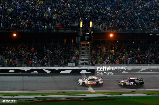 Dale Earnhardt Jr driver of the National Guard Chevrolet races ot the checkered flag to win the NASCAR Sprint Cup Series Daytona 500 at Daytona...