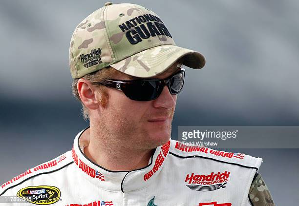 Dale Earnhardt Jr driver of the National Guard Heritage/Amp Energy Chevrolet looks on during qualifying for the NASCAR Sprint Cup Series COKE ZERO...