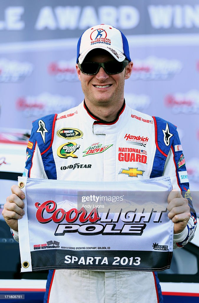 Dale Earnhardt Jr., driver of the #88 National Guard Youth Foundation Chevrolet, poses with the Coors Light Pole Award after qualifying for pole position for the NASCAR Sprint Cup Series Quaker State 400 at Kentucky Speedway on June 28, 2013 in Sparta, Kentucky.