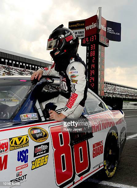 Dale Earnhardt Jr driver of the National Guard/AMP Energy Chevrolet gets out of his car after qualifying for the NASCAR Sprint Cup Series Gillette...