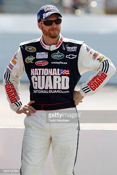 Dale Earnhardt Jr driver of the National Guard/AMP Energy Chevrolet stands on the grid during qualifying for the NASCAR Sprint Cup Series LENOX...