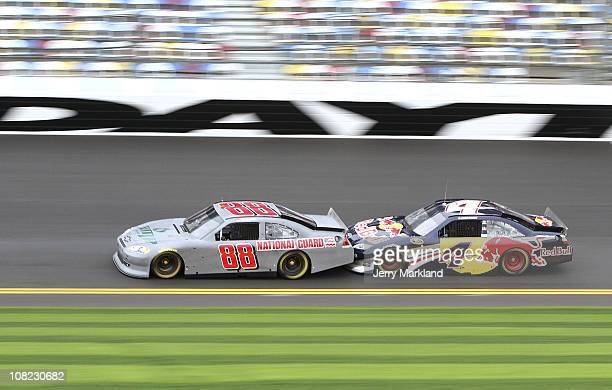 Dale Earnhardt Jr driver of the National Guard/AMP Energy Chevrolet leads Kasy Kahne during testing at Daytona International Speedway on January 21...
