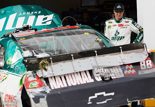 Dale Earnhardt Jr driver of the National Guard/AMP Energy Chevrolet checks his car out in the garage area after an incident in practice for the...