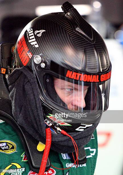 Dale Earnhardt Jr driver of the National Guard/AMP Energy Chevrolet stands in the garage during practice for the NASCAR Sprint Cup Series Goody�s...