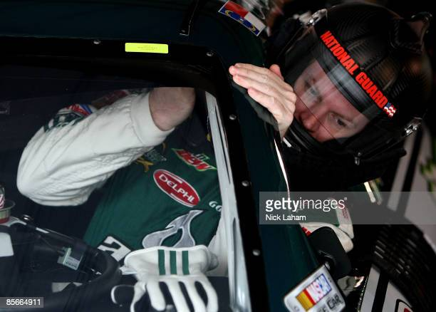 Dale Earnhardt Jr driver of the National Guard/AMP Energy Chevrolet climbs into his car during practice for the NASCAR Sprint Cup Series Goody�s Fast...